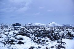 Keflavik - January 2019: Two Busses Standing On The Road In The Middle Of The Beautiful Icelandic Landscape With Snow Covered stock photos