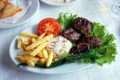 Kefte (lamb chops) with rice and French fries Stock Images