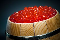 Keg of red caviar. On the dark Royalty Free Stock Images