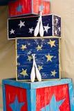 Kegelenspelden en dozen van een circus Stock Foto