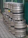 Kegs of beer. Metal beer barrels stacked outside Stock Photo