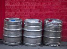 Kegs of beer. Metal beer barrels stacked outside Royalty Free Stock Images