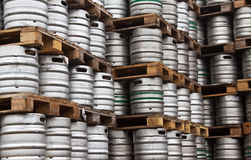 Kegs of beer in regular rows Royalty Free Stock Photos