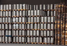 Kegs of beer in regular rows Stock Photo