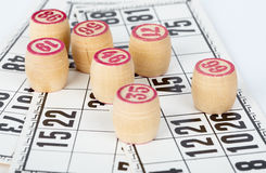 Kegs bingo, against playing cards Royalty Free Stock Photography