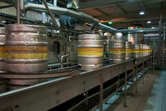 Kegs on the production line in the factory Stock Photos