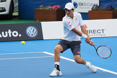 Kei Nishikori of Japan hitting bach-hand ball Royalty Free Stock Photography