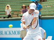 Kei Nishikori at Kooyong Tennis Club hitting backhand. Melbourne, Australia, 2016 January 13: Kei Nishikori of Japan at an Exhibition and practice match at Stock Photos