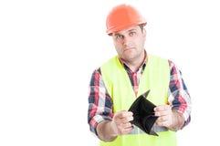 Kein Geld Konzept mit jungem Erbauer gelassen Lizenzfreies Stockfoto