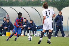 Keita Balde plays with F.C Barcelona youth team against Gimnastic de Tarragona at Ciutat Esportiva Joan Gamper Stock Photos