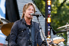 Keith Urban. NEW YORK-JUL 11: Keith Urban performs on ABC's Good Morning America at Rumsey Playfield, Central Park, on July 11, 2014 in New York City royalty free stock photo
