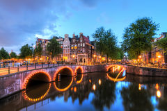 Keizersgracht bridge lights. Beautiful cityscape of the famous canals of Amsterdam, the Netherlands, at night with bridges at the Emperor`s canal keizersgracht Royalty Free Stock Photography
