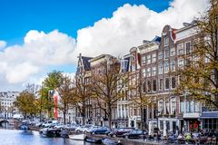 The Keizersgracht Emperor`s Canal with its cafe terraces and large historic houses in the historic center of Amsterdam stock image