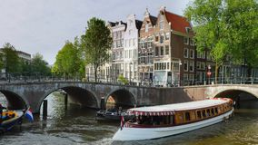 Keizersgracht and Leidsegracht in Amsterdam, Netherlands. Keizersgracht and Leidsegracht, canal with historic houses, Amsterdam, North Holland, Netherlands stock video