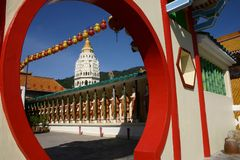 Kek lok si temple. A row of ceramic Buddhas lines a courtyard below the majestic seven-storey grand pagoda at 1891 Kek Lok Si Temple on Penang Island, Malaysia ( Stock Images