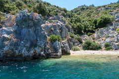 Kekova where sunken shipwrecks of Dolkisthe Antique City which was destroyed by earthquakes in the 2nd century, Tukey. Kekova is a heaven on earth where nature royalty free stock image