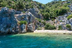 Kekova where sunken shipwrecks of Dolkisthe Antique City which was destroyed by earthquakes in the 2nd century, Tukey. Kekova is a heaven on earth where nature royalty free stock photo
