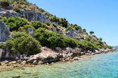 Kekova where sunken shipwrecks of Dolkisthe Antique City which was destroyed by earthquakes in the 2nd century, Tukey. Kekova is a heaven on earth where nature royalty free stock photos