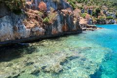 Kekova where sunken shipwrecks of Dolkisthe Antique City which was destroyed by earthquakes in the 2nd century, Tukey. Kekova is a heaven on earth where nature stock photo