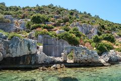 Kekova where sunken shipwrecks of Dolkisthe Antique City which was destroyed by earthquakes in the 2nd century, Tukey. Kekova is a heaven on earth where nature royalty free stock images