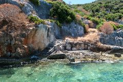 Kekova where sunken shipwrecks of Dolkisthe Antique City which was destroyed by earthquakes in the 2nd century, Tukey. Kekova is a heaven on earth where nature stock image