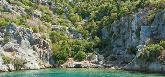 Kekova is an island that under the water preserves the ruins of Royalty Free Stock Photography