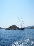 Kekova, Turkey - August 14, 2012: Kekova. sailboat near rocky shores Royalty Free Stock Photography