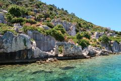 Kekova where sunken shipwrecks of Dolkisthe Antique City which was destroyed by earthquakes in the 2nd century, Tukey. Kekova is a heaven on earth where nature stock photography