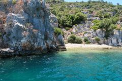 Kekova where sunken shipwrecks of Dolkisthe Antique City which was destroyed by earthquakes in the 2nd century, Tukey. Kekova is a heaven on earth where nature royalty free stock photography
