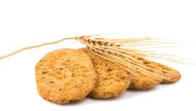 Kekse mit den Ohren des Weizens Lizenzfreie Stockbilder