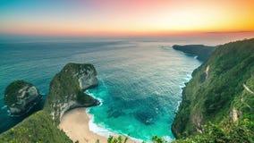 Kelingking beach giant rock sunset timelapse in Nusa Penida, Indonesia. 4K Timelapse in Nusa Penida Island, Bali, Indonesia stock video footage