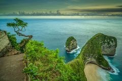Kelingking beach on Nusa Penida during a cloudy sunset stock photography
