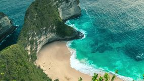 Kelingking beach on Nusa Penida island is famous for its cliffs shaped like a Tyrannosaurus Rex, Klingung regency, Bali. 4K Timelapse in Nusa Penida Island, Bali stock footage