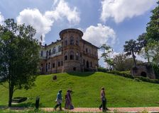 Kellie`s Castle in Batu Gajah Perak. Three visitors walking in front the Kellie`s Castle in Batu Gajah Perak Royalty Free Stock Photos