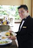 Kellner an der Gaststätte Stockbild