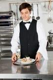 Kellner With Salmon Roll And White Wine Lizenzfreie Stockfotografie