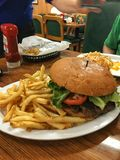 Kellys Country Cooking Giant Burger. Eating and Kells Country Kitchen where the food is big Royalty Free Stock Photos