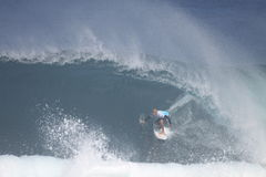Kelly Slater at Pipemasters. 9x world champ, Kelly Slater competes in the 2009 Billabong Pipemasters at Pipeline in Hawaii. This is the third event in the Triple Royalty Free Stock Images