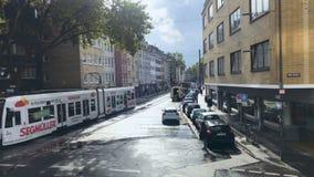 Keln, Germany - October 9, 2017 - Modern street with urban tram. Keln, Germany - October 9, 2017. Modern street with urban tram. People walking on the street stock footage