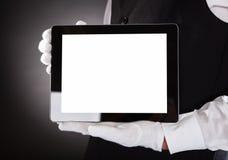 Kelner Holding Digital Tablet royalty-vrije stock foto's