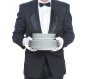 Kelner met een stapel Platen Stock Afbeeldingen
