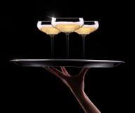 Kelner ręka z szampanem Obrazy Stock