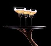 Kelner ręka z szampanem Zdjęcie Stock