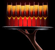 Kelner ręka z szampanem Fotografia Royalty Free