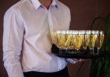 Kelner z szampanem Fotografia Royalty Free