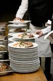 Kelners en schotels Stock Afbeeldingen