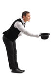 Kelnersboog die beneden en zijn hoed van start gaan Royalty-vrije Stock Afbeeldingen