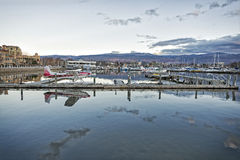 Kelowna Marina at dusk. Okanagan lake at sunset with the Kelowna Marina Royalty Free Stock Images