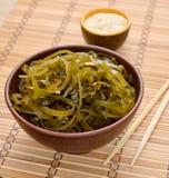 Kelp ( laminaria ) in a bowl on the white background. Stock Photos