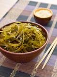 Kelp ( laminaria ) in a bowl on the white background Stock Photos